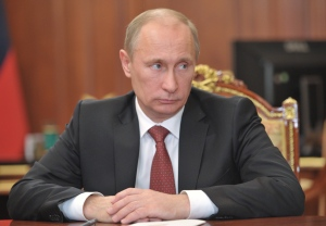 Russian President Vladimir Putin looks on during a meeting in the Kremlin in Moscow, Friday, Dec. 28, 2012. (RIA-Novosti, Alexei Nikolsky, Presidential Press Service)