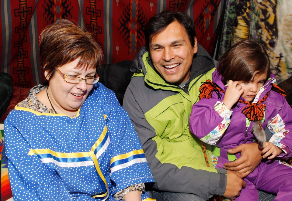 Attawapiskat Chief Theresa Spence talks with her family and First Nations actor Adam Beach and his daughter Phoenix Beach as she continues her hunger strike in a teepee on Victoria Island in Ottawa, early Tuesday, Dec. 25, 2012. (Cole Burston / THE CANADIAN PRESS)