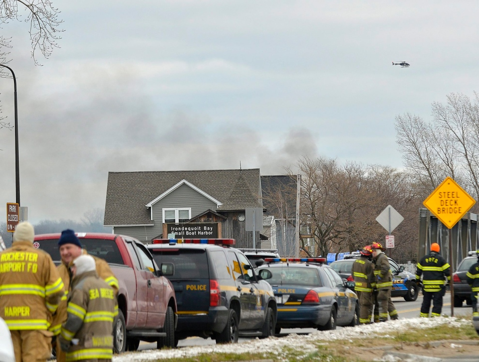 Smoke appears near the site of a fire in Webster, N.Y., Monday, Dec. 24, 2012. (AP / Seth Binnix)