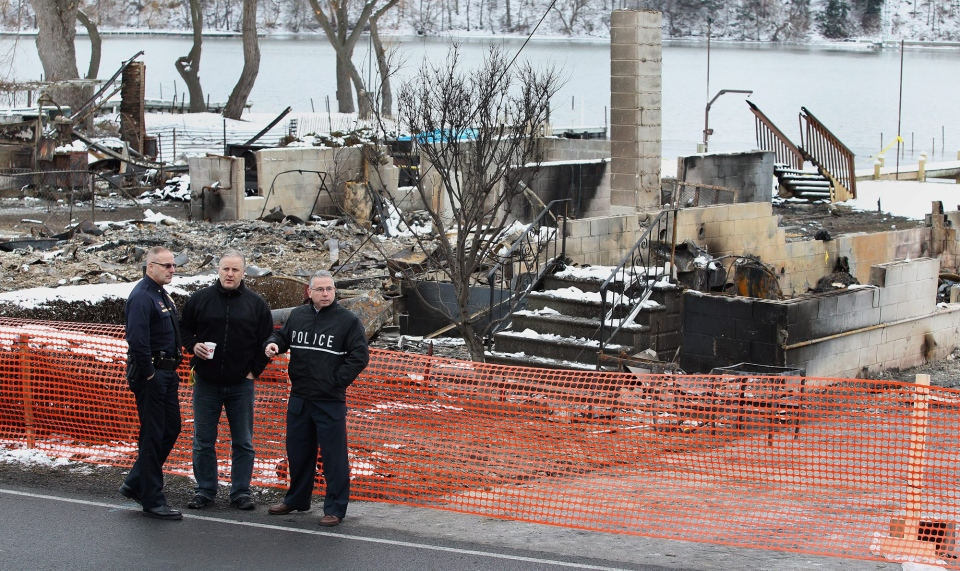 From left, Greece Police Chief Todd Baxter, with one of his officers John Ritter and a State Police investigator at the scene of Monday's fatal shooting of two firefighters on Lake Rd. in Webster, N.Y., Wednesday, Dec. 26, 2012. (AP Photo/Democrat & Chronicle, Jamie Germano)