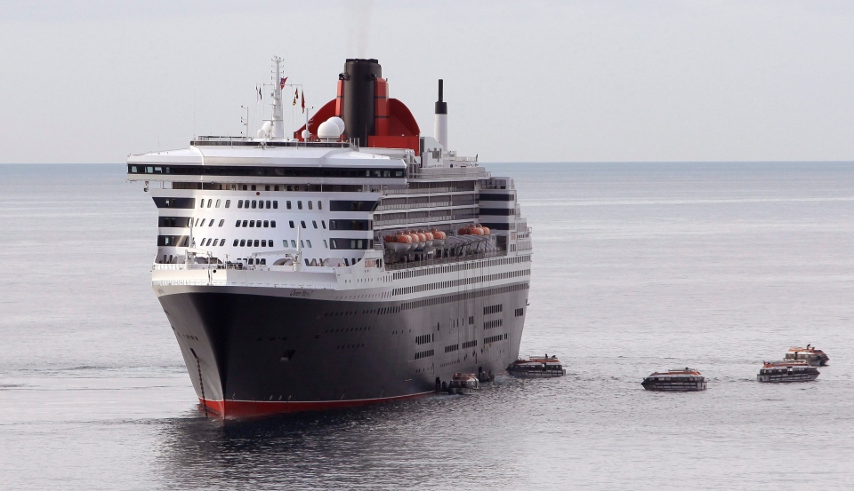 The transatlantic ocean liner Queen Mary 2 sails into in the harbor of Monaco, Thursday, April 14 , 2011. (AP / Lionel Cironneau)