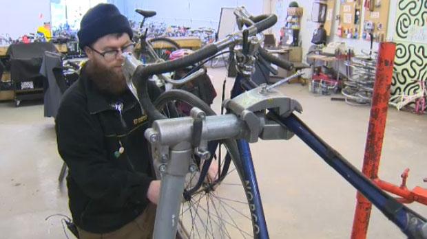 A Good Life Community member performs bike maintenance