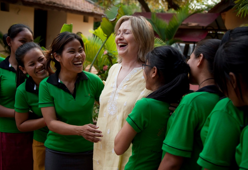 U.S. Secretary of State Hillary Rodham Clinton shares a laugh with a group of girls from the Siem Reap Center, a shelter run by AFSEIP that provides rehabilitation, vocational training, and social reintegration for sex trafficking victims in Siem Reap, Cambodia, on Sunday, Oct. 31, 2010. (AP / Evan Vucci)