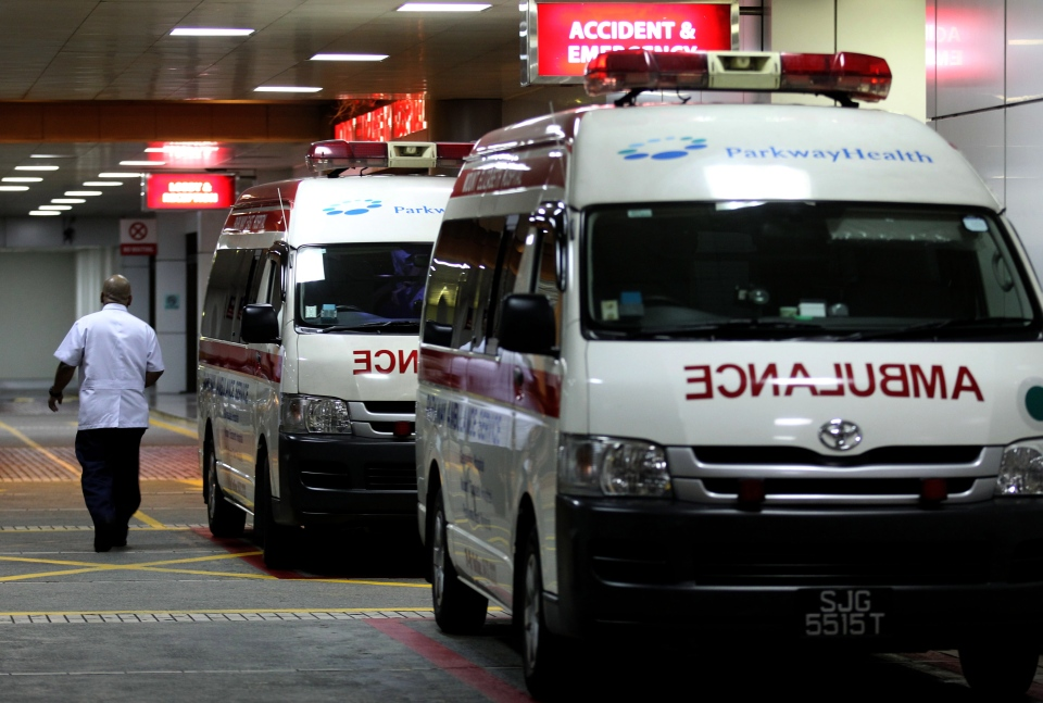 Ambulances are parked outside the accident and emergency entrance at Mount Elizabeth Hospital in Singapore, late Friday Dec. 28, 2012.  (AP / Wong Maye-E)