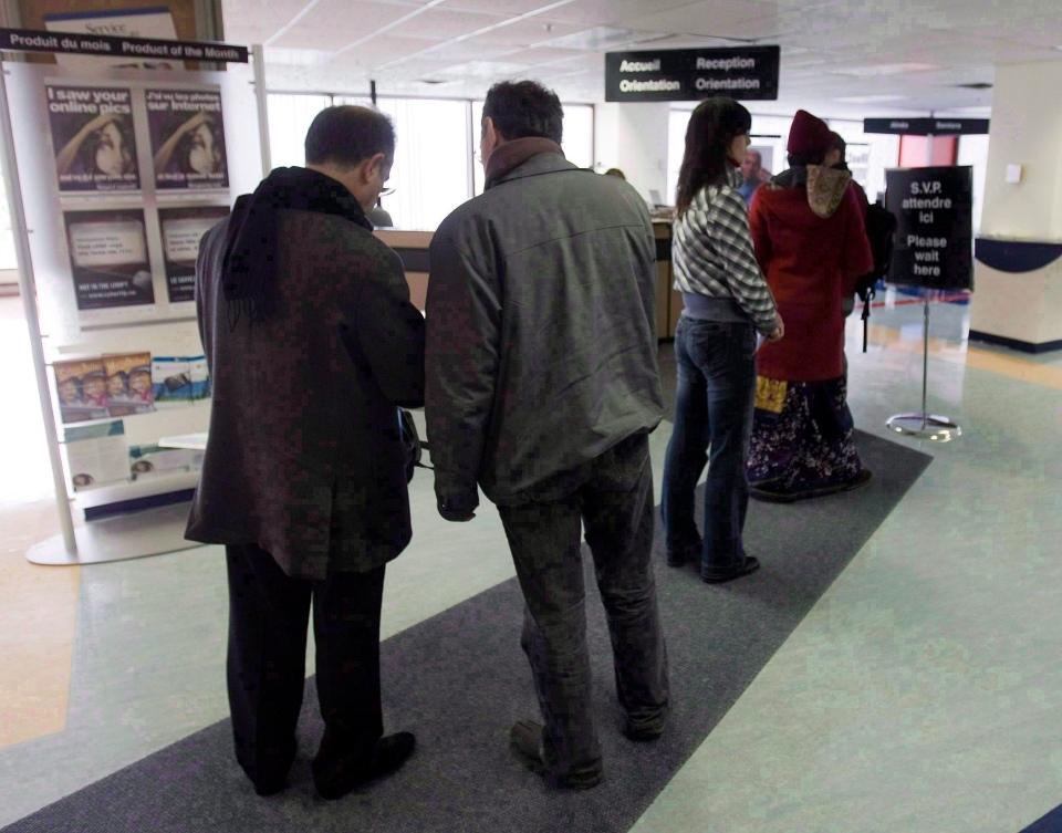 People line up at the Resource Canada offices in Montreal on April 9, 2009. Thousands of Canadians are being told that personal information about them held by the government has gone missing. (Ryan Remiorz / THE CANADIAN PRESS)