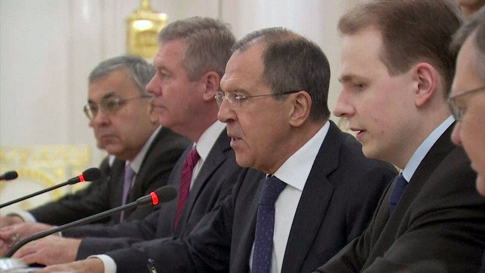 Russian Foreign Minister Sergei Lavrov, centre, has recognized Syria's opposition coalition as legitimate, and is pushing for peace talks.