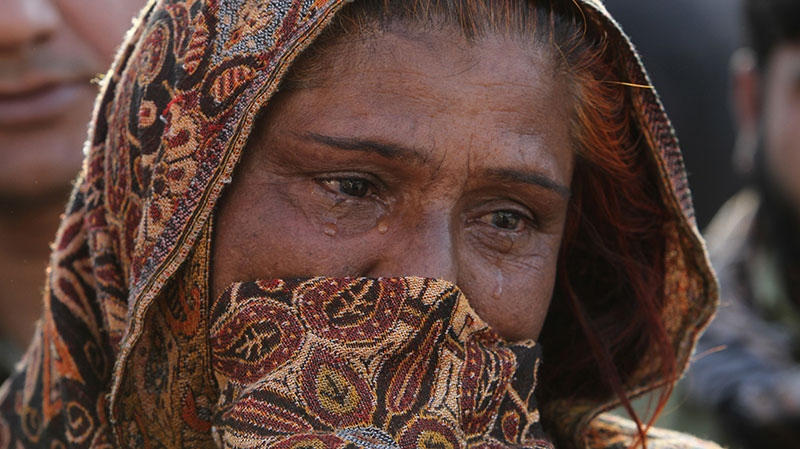 A Pakistani woman grieves after losing her son in a blast, at a local hospital in Karachi, Pakistan on Saturday, Dec. 29, 2012. (AP / Shakil Adil)