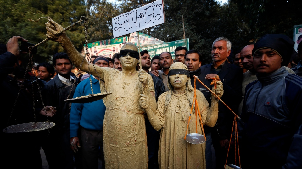 A man and a woman dressed as Lady Justice join mourners after news of the death of a gang rape victim in New Delhi, India, Saturday, Dec. 29, 2012. (AP / Saurabh Das)