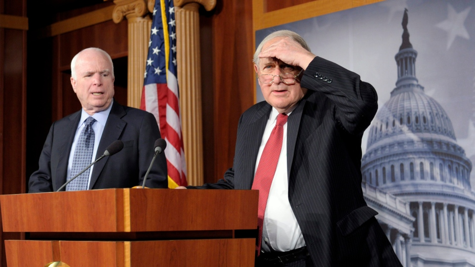 Senate Armed Services Committee Chairman Sen. Carl Levin, D-Mich., right, accompanied by the committee's ranking Republican, Sen. John McCain, R-Ariz., looks into the audience prior to speaking at a news conference on Capitol Hill in Washington, Friday, Dec. 28, 2012. (AP / Susan Walsh)