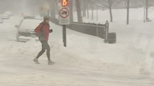 15 cm of snow won't stop this man from running, not walking, across the street (Dec. 7, 2010)