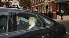 WikiLeaks founder Julian Assange, back to camera, is driven into Westminster Magistrates Court in London Tuesday Dec. 7, 2010 after being arrested on a European Arrest Warrant. (AP / Stefan Rousseau / PA)