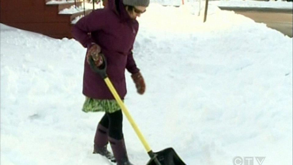 Marie Blythe shovels snow in Moncton, N.B., Saturday, Nov. 29, 2012.