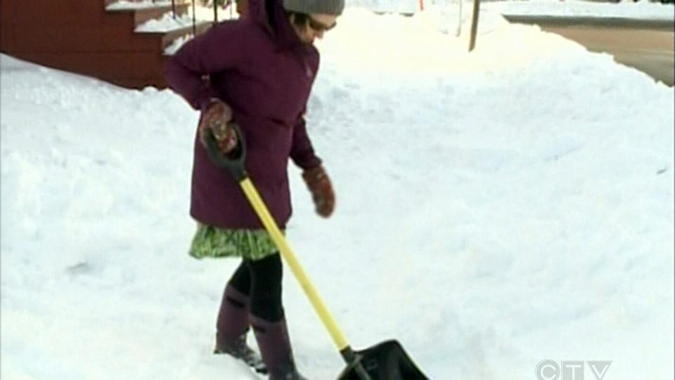 Marie Blythe shovels snow in Moncton, N.B., Saturday, Nov. 29, 2012.