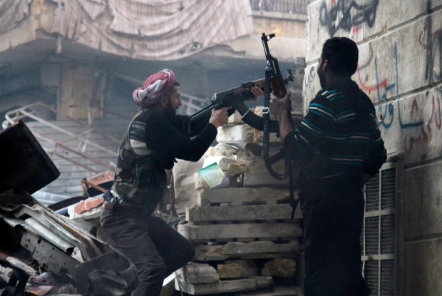 Free Syrian Army fighters fire at enemy positions