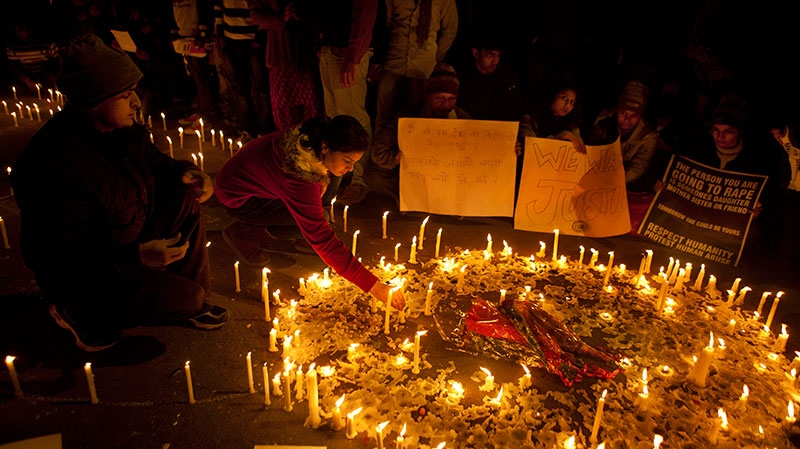 Indians light candles as they mourn the death of a gang rape victim in New Delhi, India, Sunday, Dec. 30, 2012. (AP / Dar Yasin)