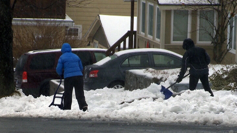 Neighbours get a head start shoveling driveways ahead of a major snowstorm predicted to hit Halifax, N.S. on Sunday, Dec. 30, 2012.