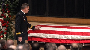 Webster Police Chief Gerald Pickering at the casket of firefighter and Webster police officer Michael Chiapperini during his funeral service, Sunday Dec. 30, 2012 at Webster Schroeder High School in Webster, N.Y. (AP / Democrat & Chronicle, Jamie Germano, Pool)