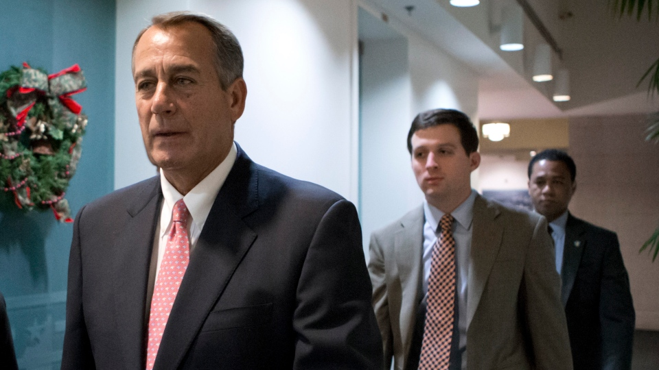 Speaker of the House John Boehner, R-Ohio, walks to a closed-door GOP caucus as Congress meets to negotiate a legislative path to avoid the so-called 'fiscal cliff' of automatic tax increases and deep spending cuts that could kick in Jan. 1., at the Capitol in Washington, Sunday, Dec. 30, 2012. (AP / J. Scott Applewhite)
