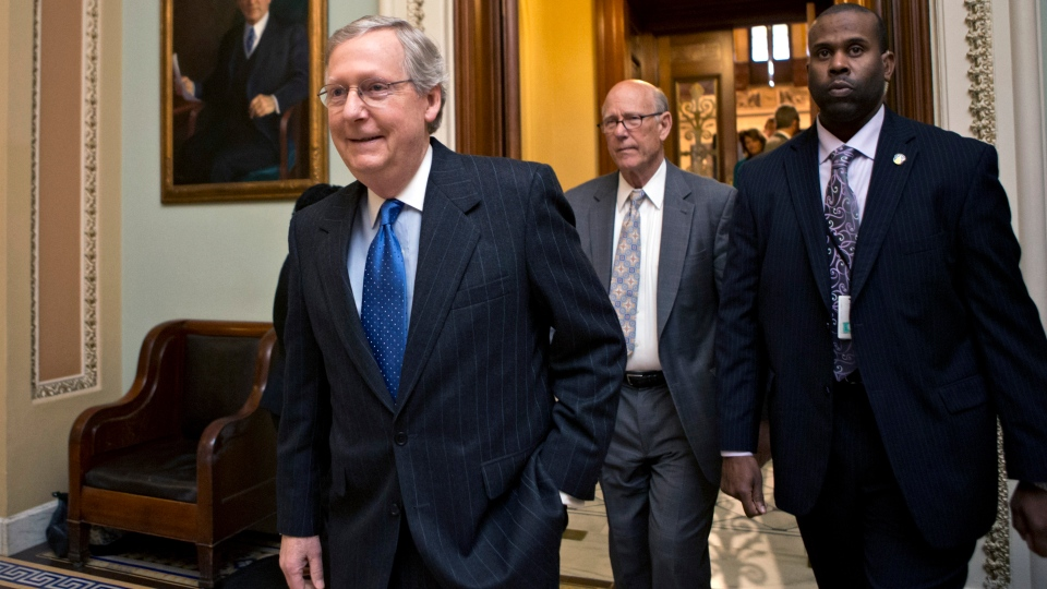 Senate Minority Leader Mitch McConnell, R-Ky., followed by Sen. Pat Roberts, R-Kan., second from right, leaves the Senate chamber to meet with fellow Republicans in a closed-door session as the 'fiscal cliff' negotiations continue at the Capitol in Washington, Sunday, Dec. 30, 2012. (AP / J. Scott Applewhite)