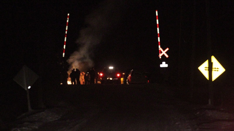 First Nations protesters block a CN rail line east of Belleville, Ont., on Sunday, Dec. 30, 2012.  (Lars Hagberg / THE CANADIAN PRESS)