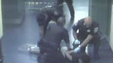 A judge ruled last month that Stacy Bonds, shown on the ground, was treated unlawfully by Ottawa police officers in September 2008.
