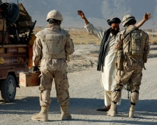 Canadian troops - members of the 1st Battalion Royal 22e Regiment - search an Afghan villager returning to his home in Folda, Afghanistan, in the restive Panjwaii district of Kandahar on Nov. 23, 2010. (THE CANADIAN PRESS/Murray Brewster)