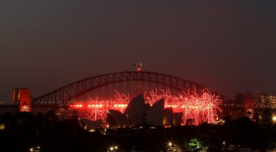 Fireworks explode around the Opera House during the pre New Years Eve celebrations in Sydney, Australia, Monday, Dec. 31, 2012.(AP Photo/Rob Griffith)
