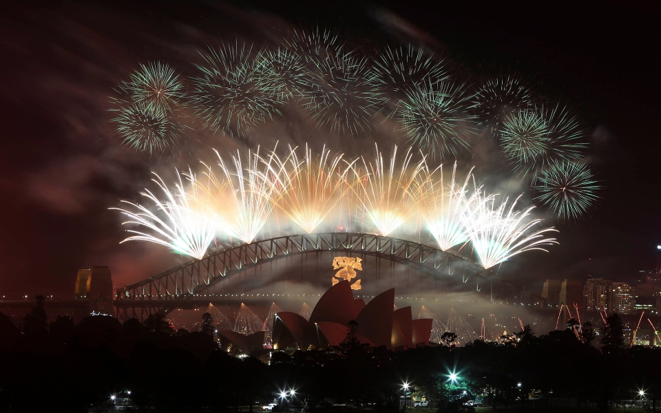 Fireworks explode in the sky above Sydney Harbour during New Year's Eve celebrations in Sydney, Australia, Monday, Dec. 31, 2012. (AP / Rob Griffith)