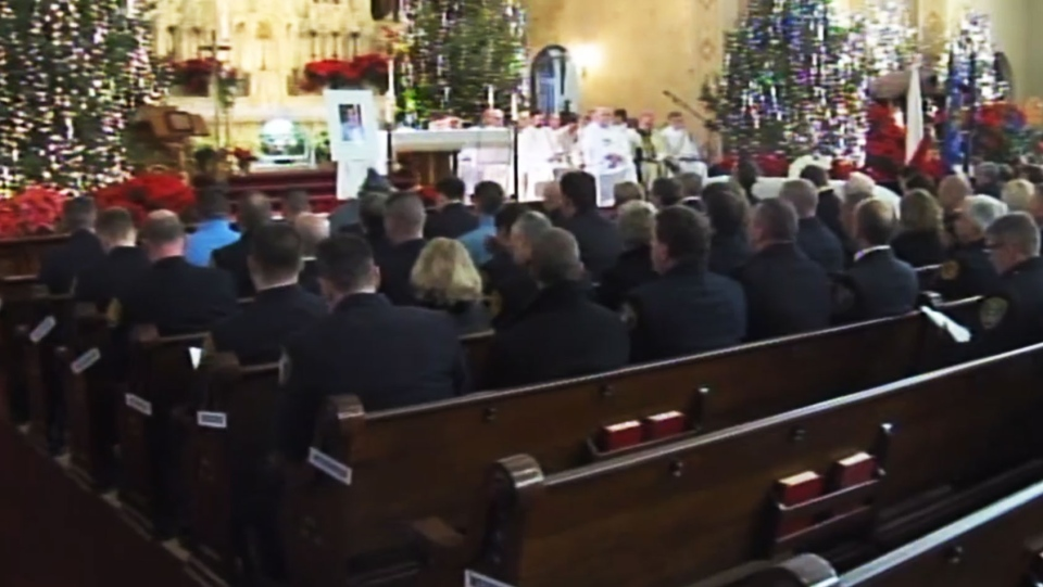 The funeral service for Tomasz Kaczowka  is held in Webster, N.Y., Monday, Dec. 31, 2012.