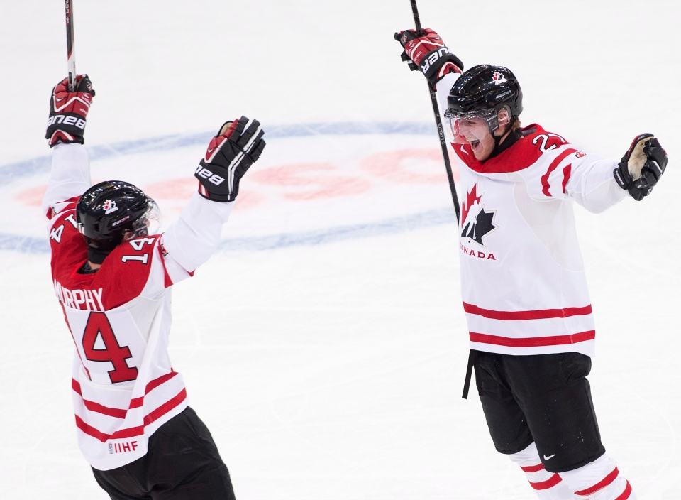 Team Canada defenceman Dougie Hamilton, right, reacts with teammate Ryan Murphy, left, after scoring a goal while playing against Russia during first period IIHF World Junior Championships hockey action in Ufa, Russia on Monday, Dec. 31, 2012. (Nathan Denette / THE CANADIAN PRESS)