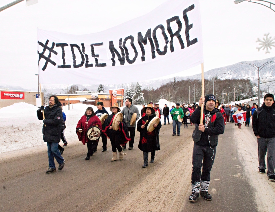 Members of the Haisla First Nation march in Kitimat, B.C. as part of a rally in support of the Idle No More movement on Sunday Dec 30, 2012. (Robin Rowland / The Canadian Press)