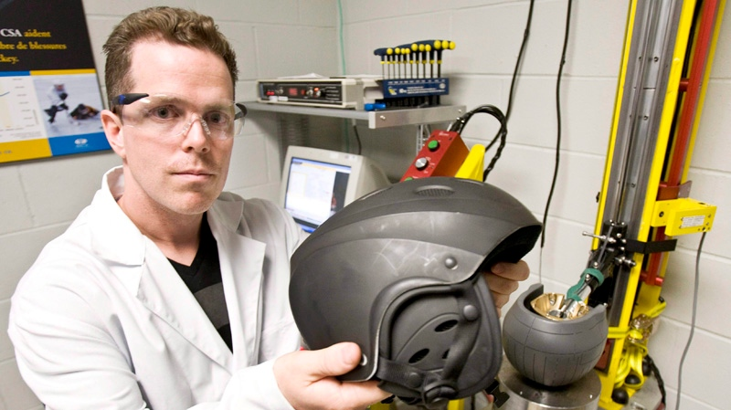 Test technician Patrick Richard show a ski helmet tested at the Canadian Standards Association International laboratory, April 30, 2009 in Montreal. (THE CANADIAN PRESS / Paul Chiasson)