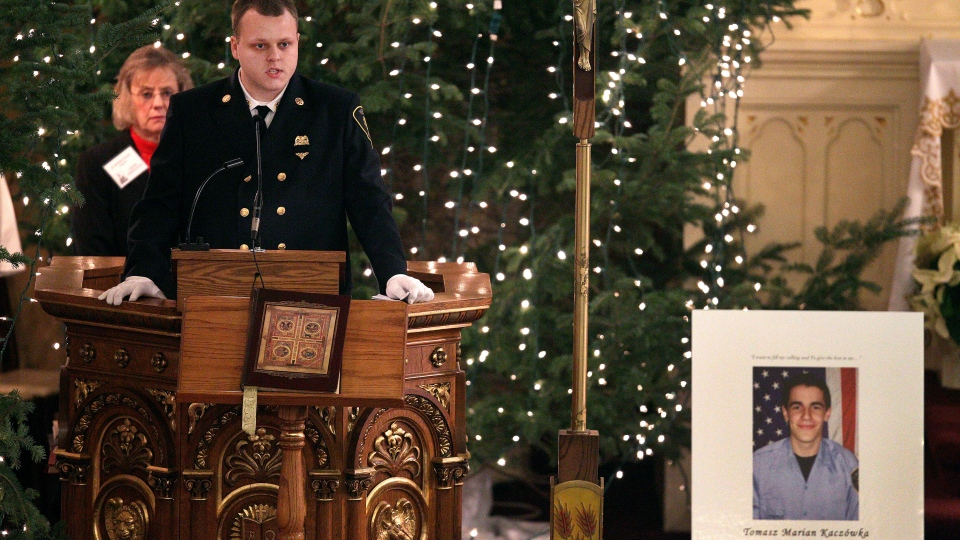 West Webster firefighter Nick Chiapperini speaks of his friend and fellow West Webster firefighter Tomasz Kaczowka during his funeral at St. Stanislaus Church in Rochester, New York, Monday Dec. 31, 2012. (Democrat and Chronicle, Jamie Germano)