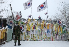 A South Korean army soldier reads messages