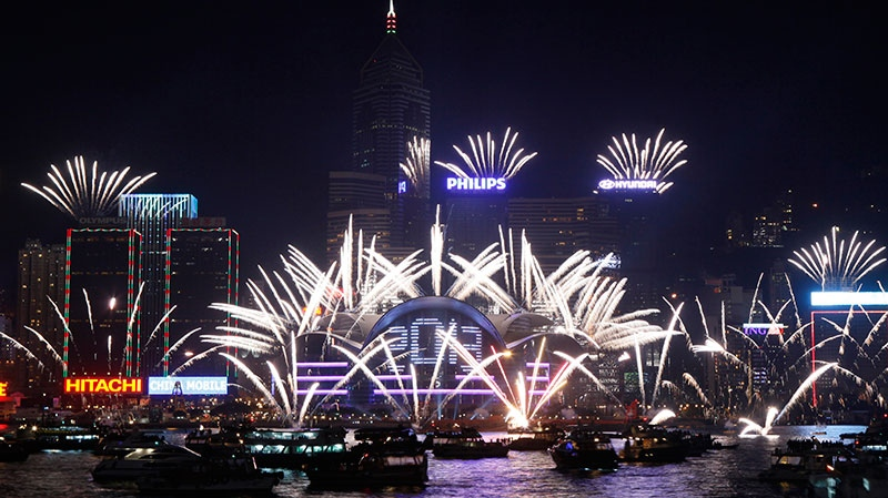 Fireworks explode at the Hong Kong Convention and Exhibition Centre over the Victoria Harbor to celebrate the 2013 New Year in Hong Kong Tuesday, Jan. 1, 2013 (AP / Kin Cheung)
