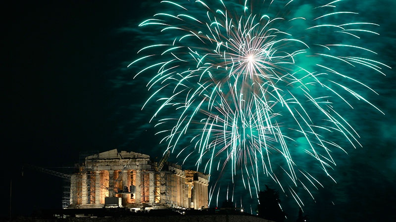 Fireworks explode over the ancient Parthenon temple at the Acropolis Hill during the New Year's celebrations in Athens, on Tuesday Jan. 1, 2013. (AP / Petros Giannakouris)