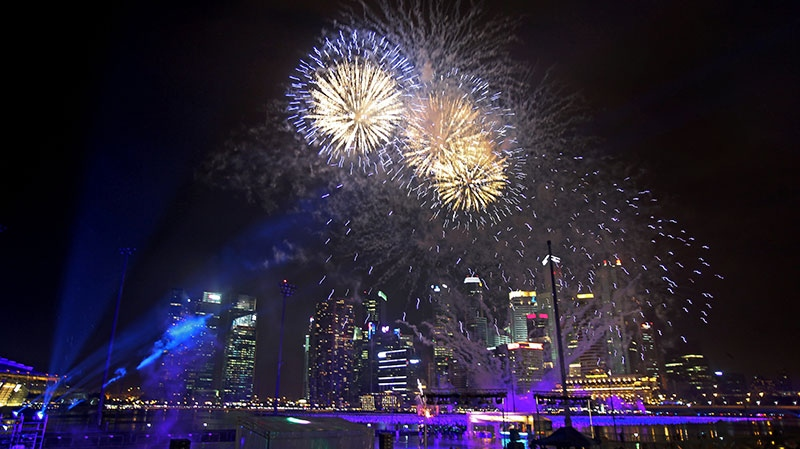 Fireworks explode over the Singapore financial district to mark the start of the new year in Singapore on Tuesday, Jan. 1, 2013. (AP / Wong Maye-E)