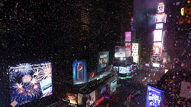 Confetti flies over New York's Times Square after the clock strikes midnight during the New Year's Eve celebration as seen from the Marriott Marquis hotel Tuesday, Jan. 1, 2013 in New York. (AP / Mary Altaffer)