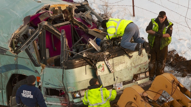 Workers move a bus that plummeted down an embankment in rural Oregon, killing nine people, on Monday, Dec. 31, 2012. (The Oregonian, Randy L. Rasmussen)