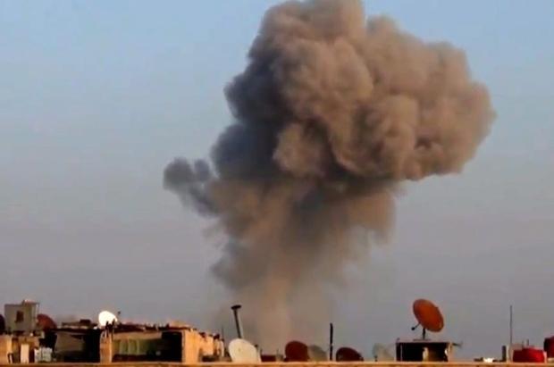Smoke rises above Damascus