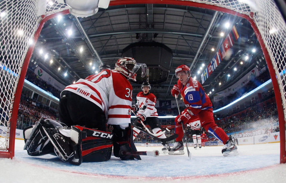 Canada's goalie Malcolm Subban and Ryan Nugent-Hopkins look on as Russia's Alexander Khokhlachyov goes to the net during the first period of their preliminary round game during the 2013 IIHF U20 World Junior Hockey Championship in Ufa on Dec. 31, 2012. (Mark Blinch / THE CANADIAN PRESS)