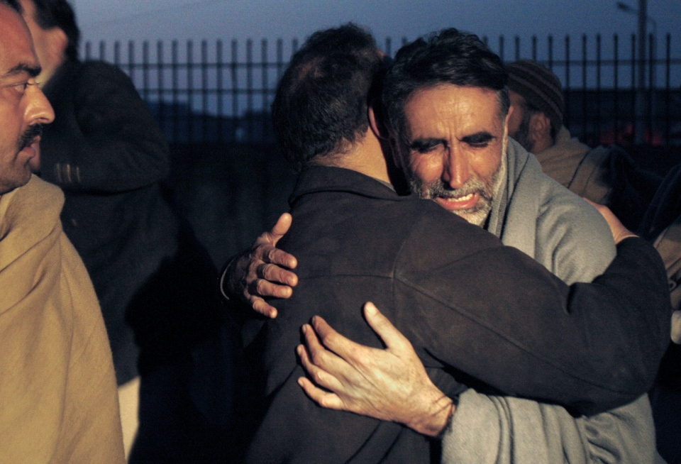 A father of an aid worker, who was killed by gunmen, mourns the death of his daughter at a hospital in Swabi, Pakistan, Tuesday, Jan. 1, 2013. (AP / Mohammad Sajjad)