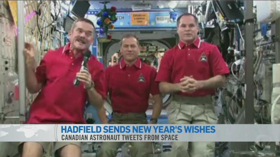 Canadian astronaut Chris Hadfield takes a moment to send his New Year greetings from space from the International Space Station on Tuesday, Jan. 1, 2012.