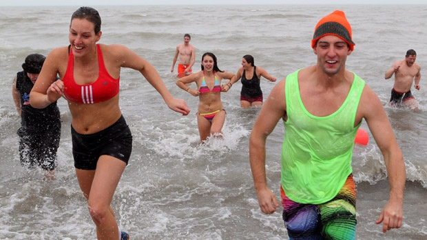 Participants in the Freezin' for a Reason Polar Bear Dip run into a freezing cold Lake Huron in Sarnia, Ont., on Saturday, Dec. 29, 2012. (Dave Chidley / THE CANADIAN PRESS)