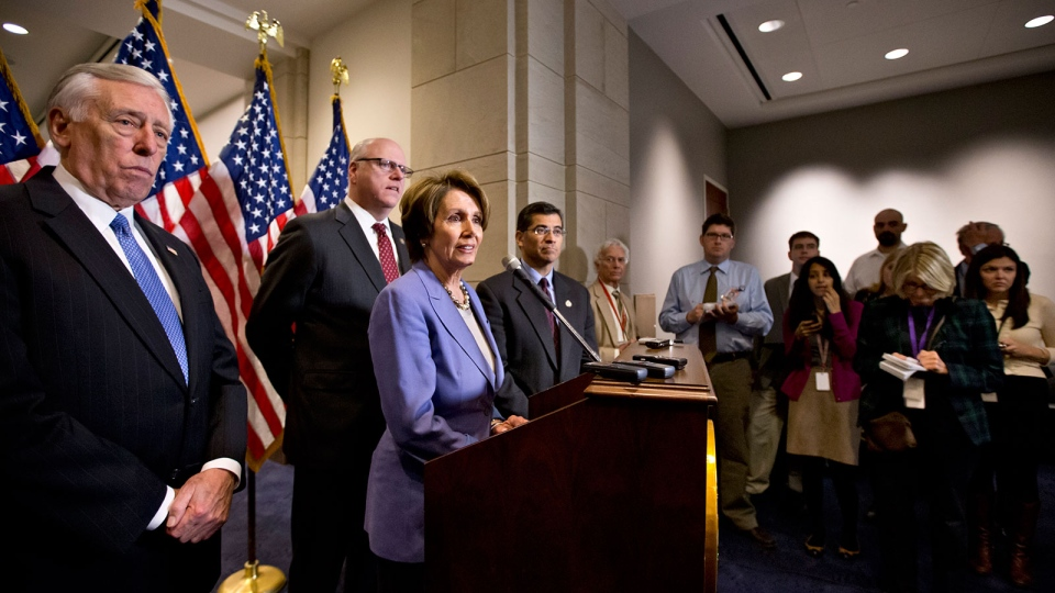 U.S. House Minority Leader Nancy Pelosi of Calif., centre, and the House Democratic leadership talks to reporters on Capitol Hill in Washington, Tuesday, Jan. 1, 2013. (AP / J. Scott Applewhite)
