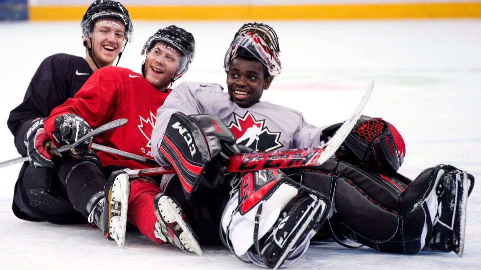 Team Canada teammates Dougie Hamilton, left, Anthony Camara, centre, and Malcolm Subban, right, ham it up for the cameras, pretending to bobsleigh during practice at the IIHF World Junior Championships in Ufa, Russia on Saturday, Dec. 29, 2012. (Nathan Denette / THE CANADIAN PRESS)