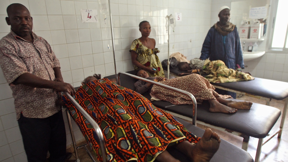 Injured people are seen at a hospital with their family members standing with them, after they were involved in a stampeded in Abidjan, Ivory Coast, Tuesday, Jan. 1, 2013. (AP / Emanuel Ekra)