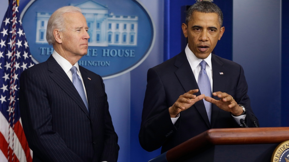 President Barack Obama and Vice President Joe Biden make a statement regarding the passage of the fiscal cliff bill in the Brady Press Briefing Room at the White House in Washington, Tuesday, Jan. 1, 2013. (AP / Charles Dharapak)