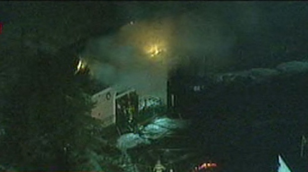 Firefighters battle a blaze at a water pumping station in Bolton early Wednesday, Jan. 2, 2013.