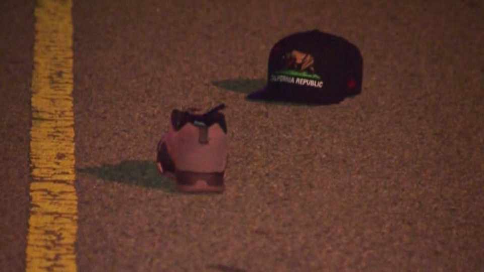 The hat and shoe of a photographer is seen after he was hit by a car and killed after taking photos of Justin Bieber's white Ferrari on a Los Angeles street on Tuesday, Jan. 1, 2013.